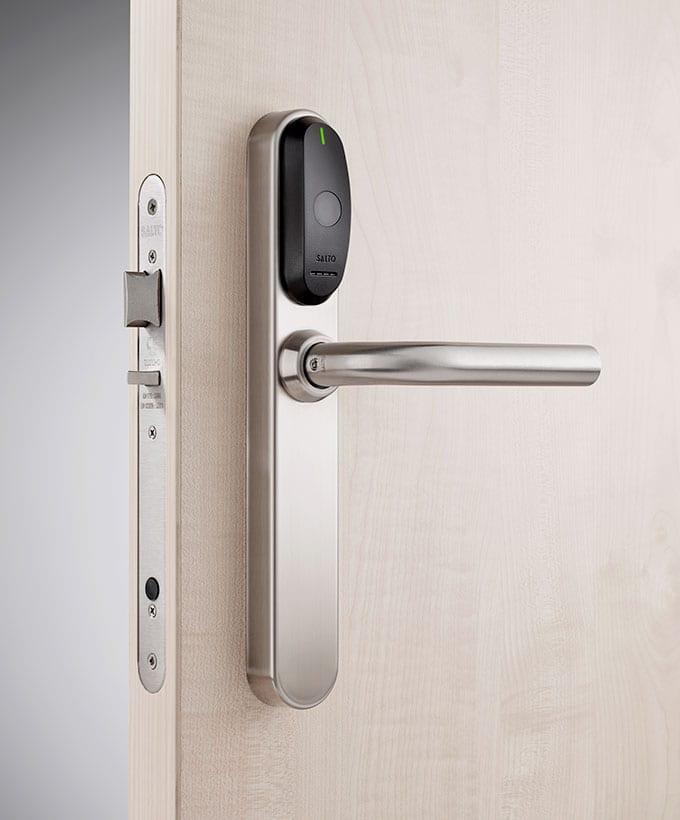Beech coloured wooden door with Salto security door handle.
