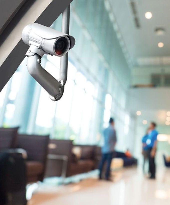 Blurred auditorium with security camera in focus.